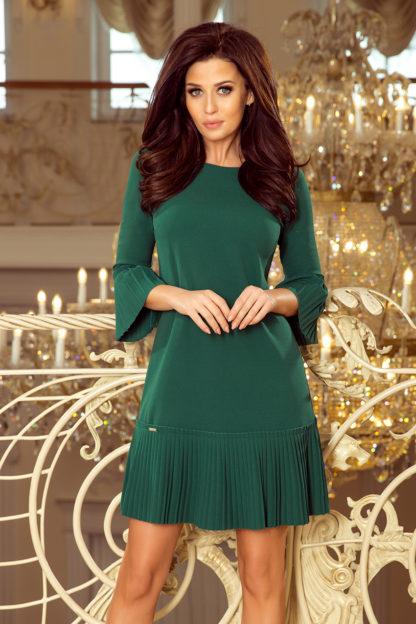 Elegancka sukienka z plisowaną falbaną i zieleń