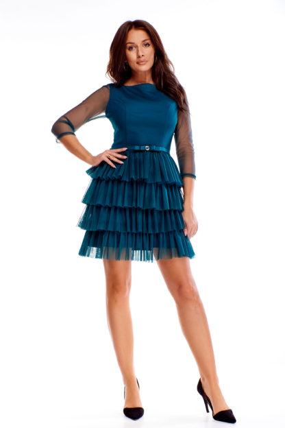 Elegancka sukienka z prześwitującymi rękawami