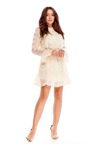 Elegancka sukienka z pomponikami