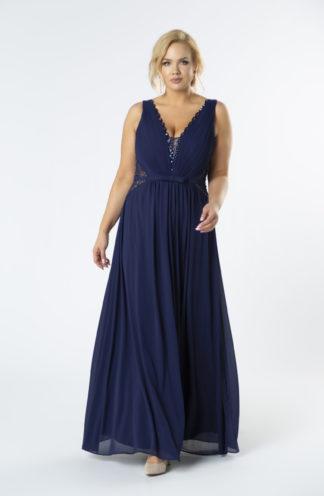 Tiulowa suknia z głębokim dekoltem